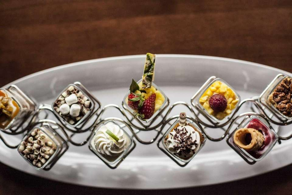 Seasons 52, Garden City: Miniature desserts are served