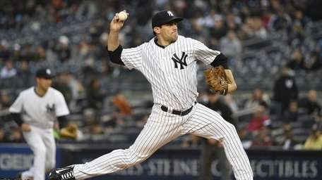 New York Yankees starting pitcher Nathan Eovaldi delivers
