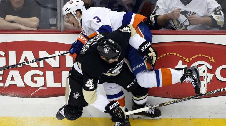 Pittsburgh Penguins' Rob Scuderi collides with New York
