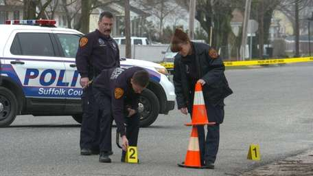 Police investigate the scene Friday, April 10, 2015,