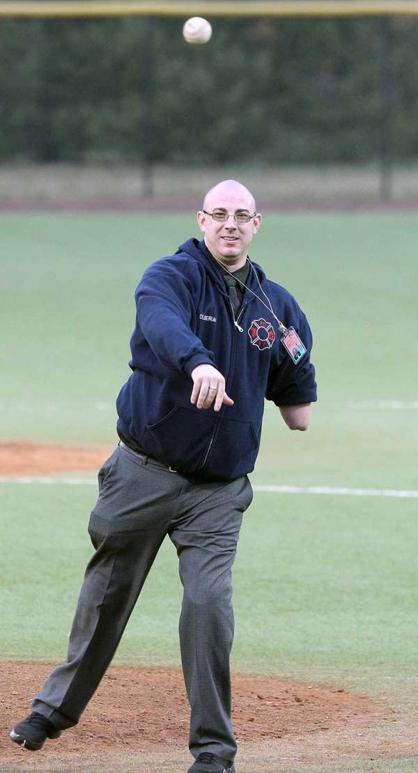 Triple-amputee Bryan Dilberian throws out the first pitch