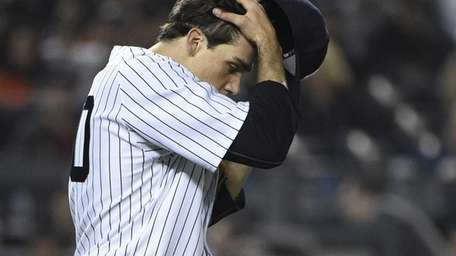 New York Yankees starting pitcher Nathan Eovaldi reacts