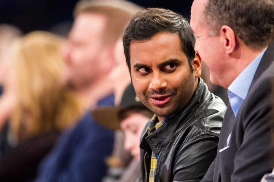 Actor and comedian Aziz Ansari watches the game