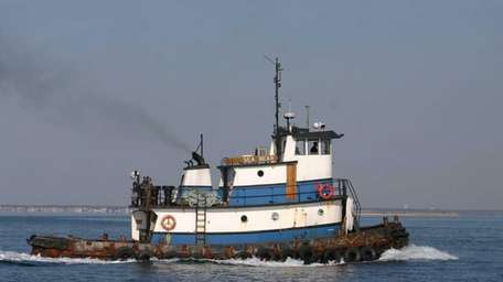 The tugboat Sea Bear is seen operating in