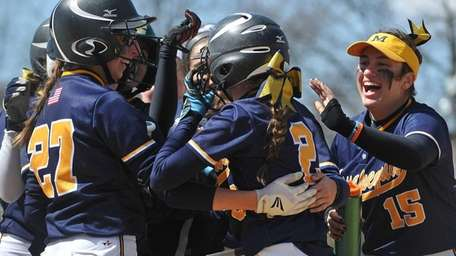 Massapequa designated player Monica Hoar, second from right,