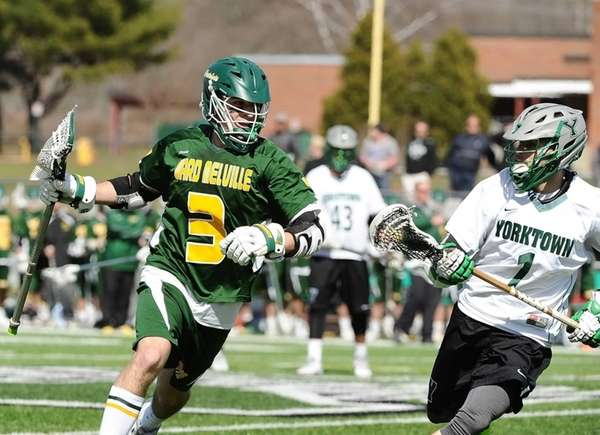 Jake McCulloch of Ward Melville is defended by