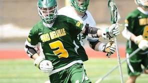 Jake McCulloch of Ward Melville runs at mid