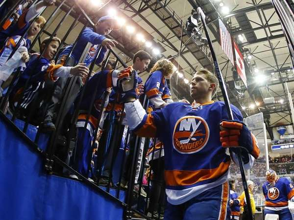 Josh Bailey of the New York Islanders  greets fans after warming up before a game against the Columbus Blue Jackets at Nassau Coliseum on Saturday, April 11, 2015, in Uniondale.