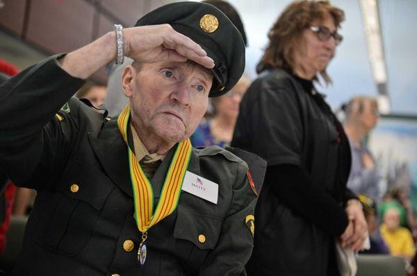 Vietnam veteran Sgt. Ronald Matty salutes as the