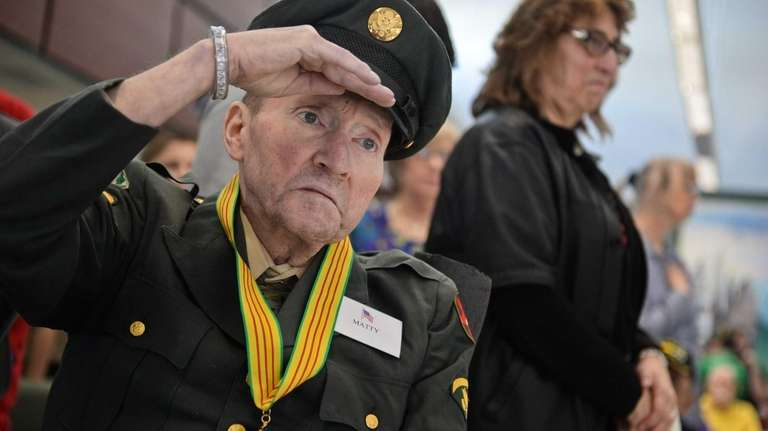 Vietnam veteran Sgt. Ronald Matty salutes as the