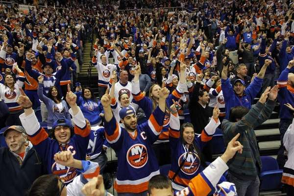 New York Islanders fans cheer after a third-period