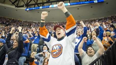 Islander fans cheering and shouting after a goal