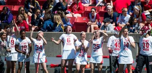 Stony Brook celebrates its win over Northwestern after