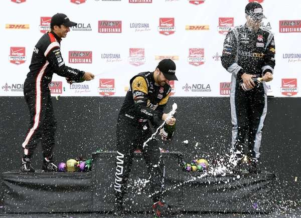 Winner James Hinchcliffe, center, runner up Hello Castroneves,