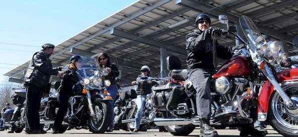Bikers arrive at the H. Lee Dennison Building