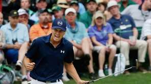 Jordan Spieth reacts to a par-saving putt on