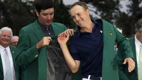 Bubba Watson helps Jordan Spieth put on his