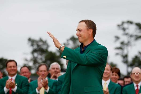 Jordan Spieth poses with the green jacket after