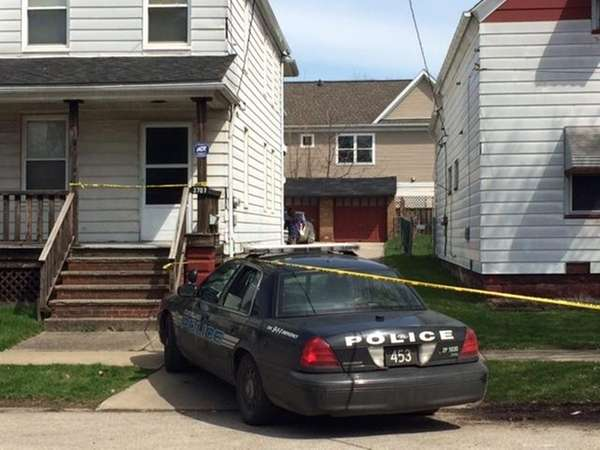 Authorities investigate the scene after a shooting involving