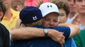 Jordan Spieth of the United States is greeted
