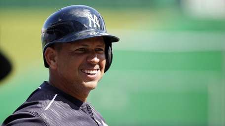 Yankees third baseman Alex Rodriguez (13) smiles during