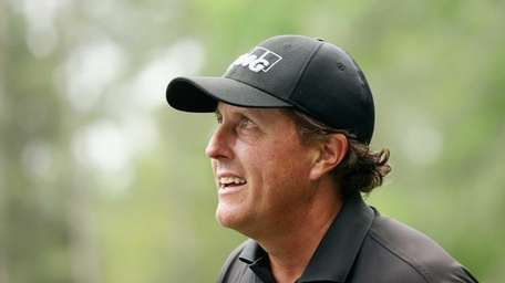 Phil Mickelson looks on during the final round