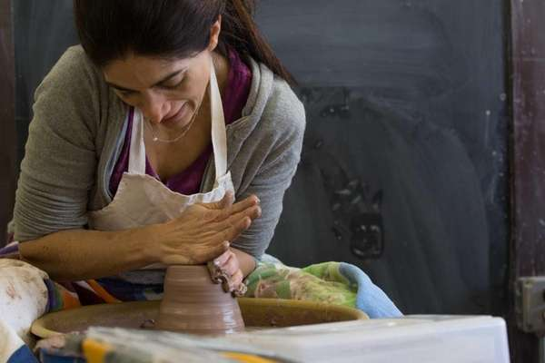 Donna Sirounian, of Garden City, works with clay