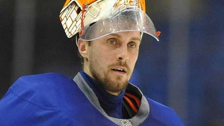Islanders goalie Jaroslav Halak skates during practice at