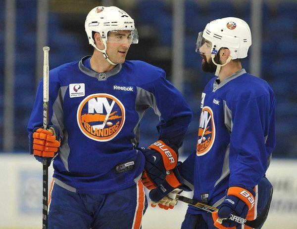 Islanders defensemen Johnny Boychuk, left, and Nick Leddy