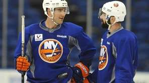 Islanders defensemen Johnny Boychuk, left, and Nick Leddy