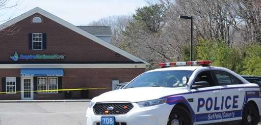 Suffolk County police patrol car sit in front