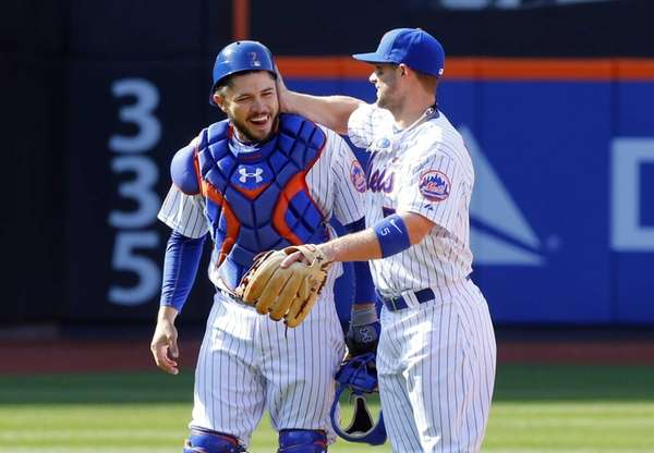 Travis d'Arnaud #7 and David Wright #5 of