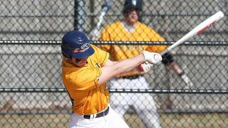 Ward Melville's Joseph Flynn (24) hits a triple