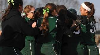 Seaford teammates celebrate after their 5-4 win over