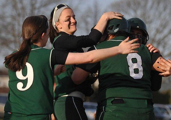Seaford teammates mob catcher Brittney Lazar after she