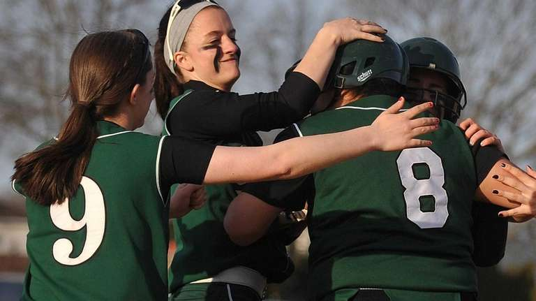 Seaford teammates mob catcher Brittney Lazar after she