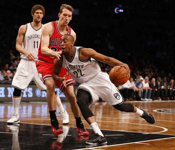 Markel Brown of the Brooklyn Nets drives toward
