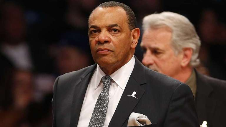 Lionel Hollins of the Brooklyn Nets walks off