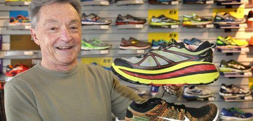 Bob Cook of Runner's Edge in Farmingdale holds