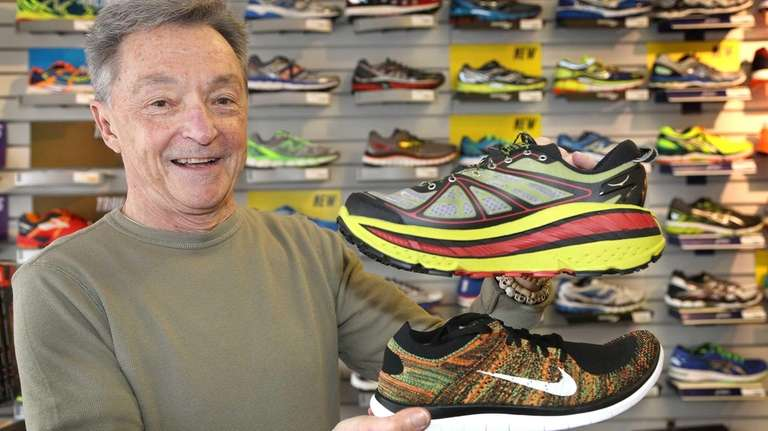 Bob Cook of Runner's Edge in Farmingdale holds