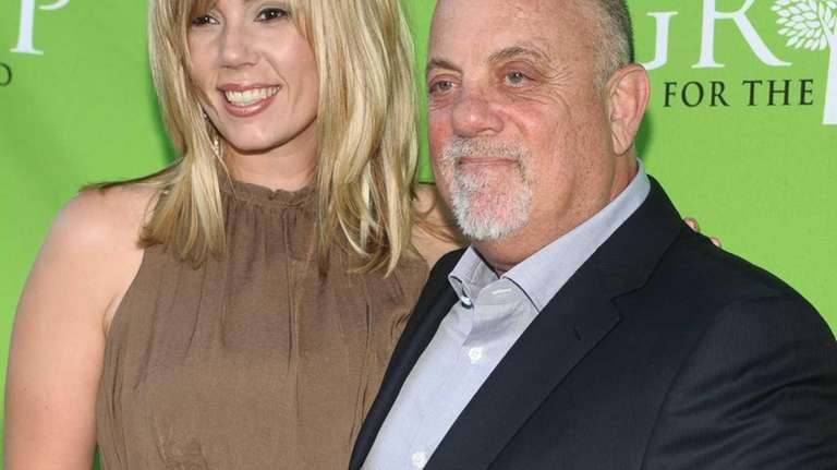Alexis Roderick and Billy Joel attend the Group