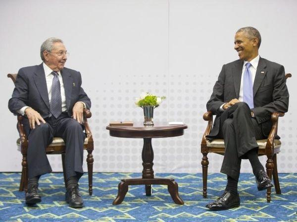 U.S. President Barack Obama, right, smiles as he