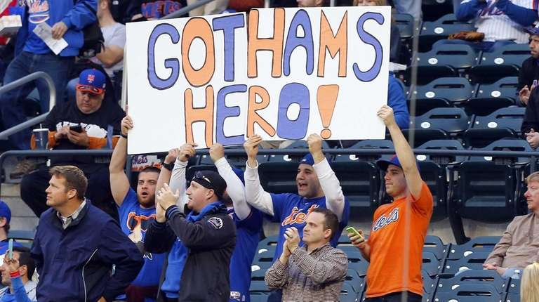 New York Mets fans hold a Matt Harvey