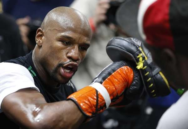 Floyd Mayweather Jr., left, works out with his