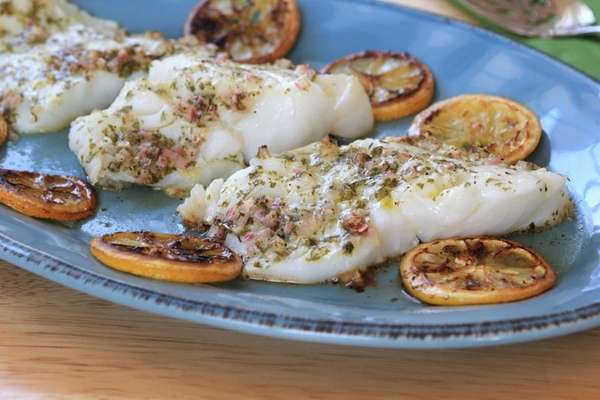 Cod drizzled with a shallot vinaigrette is roasted