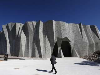 """A visitor walks in front of the """"caverne"""