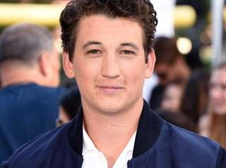 Miles Teller attends The 2015 MTV Movie Awards