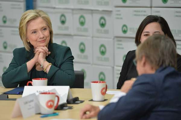 Hillary Rodham Clinton speaks with a group of
