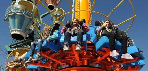 People enjoy a new ride called Twist and