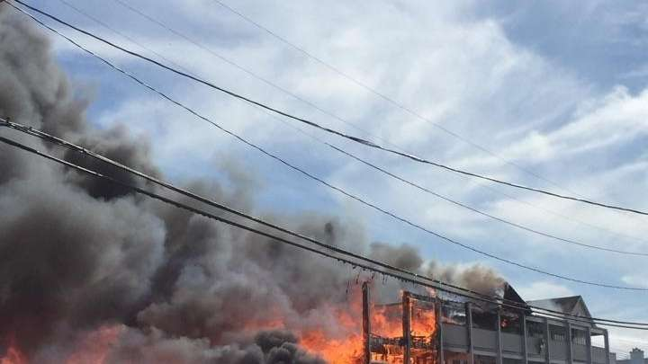 Emergency personnel battle a fire at the Sand